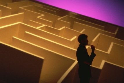 Pensive businessman with maze