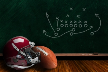 Football Equipment and Chalk Board Play Strategy Background